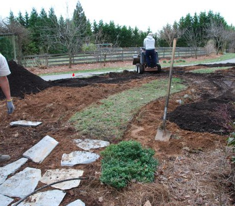 3. Extending stone path, spreading compost