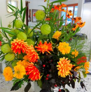 "A combination of Dahlias, Marigolds, Helenium Mardi Gras, and the giant round seed pods of Aesclepias 'Hairy Balls"" (I didn't name it.)"